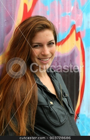 Portrait Of A Woman stock photo, Portrait of a woman with colorful wall in the background. by Henrik Lehnerer