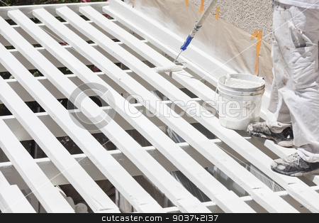 Painter Rolling White Paint Onto Top of Patio Cover stock photo, Painter Rolling White Paint Onto The Top of A Home Patio Cover. by Andy Dean