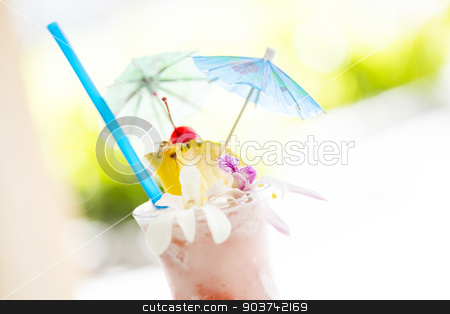 Fruity Tropical Drink with Pineapple and Umbrullas stock photo, Fruity Tropical Drink with Pineapple and Umbrullas at the Bar. by Andy Dean