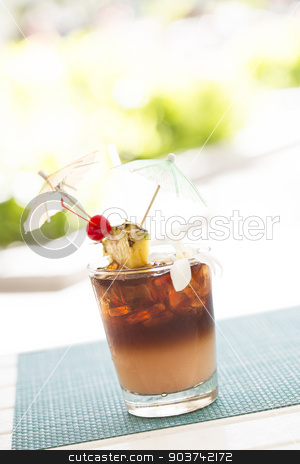 Ice Cold Mai Tai Cocktail Drink with Fruit and Umbrullas stock photo, Ice Cold Mai Tai Cocktail Drink with Fruit and Umbrullas at the Bar. by Andy Dean