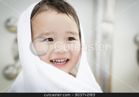 Mixed Race Boy Having Fun at the Water Park stock photo, Mixed Race Boy Having Fun at the Water Park with White Towel On His Head. by Andy Dean