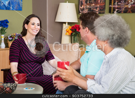 Expecting Surraogate Mother with Friends stock photo, Smiling expecting surrogate mother with mature male friends by Scott Griessel