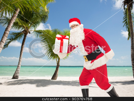 man in costume of santa claus with gift box