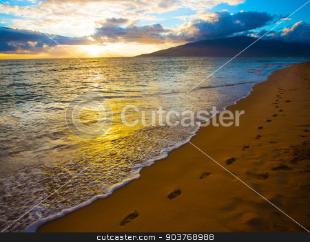 Kihei Sunset and Beach Footprints stock photo, Footprints along beautiful beach on Maui in Hawaii by Scott Griessel