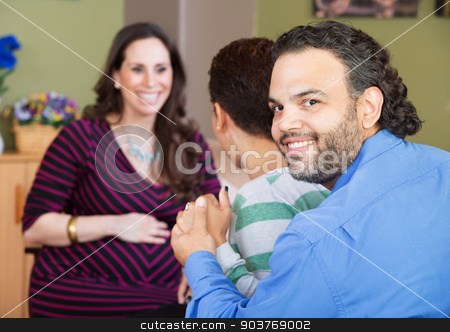 Latino Couple with Surrogate Mother stock photo, Smiling Latino man with wife and surrogate mother by Scott Griessel
