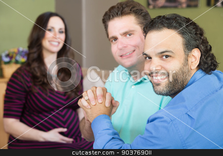 Happy Gay Parents with Pregnant Woman stock photo, Handsome gay men holding hands with smiling surrogate mother by Scott Griessel