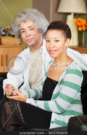 Cute Wife and Mature Man stock photo, Attractive young and middle aged Black couple holding hands by Scott Griessel
