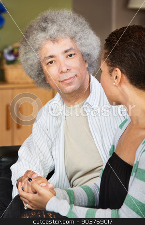 Handsome Man with Wife stock photo, Calm handsome Black man holding hand of woman by Scott Griessel