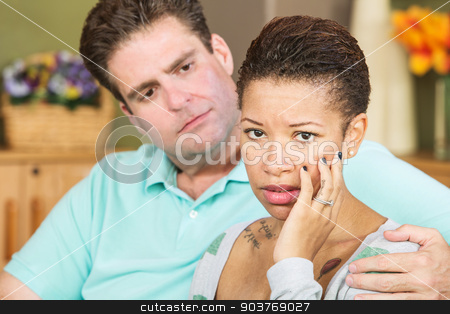 Worried Woman with Husband stock photo, Worried mixed Black and White couple sitting together by Scott Griessel