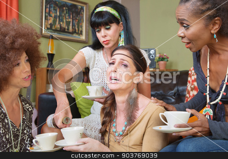 Sobbing Woman with Friends and Alcohol stock photo, Friends pouring whiskey in teacup of crying female by Scott Griessel