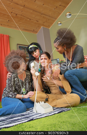 Sympathetic Friends with Hippie Lady stock photo, Group of four 1960s middle aged women crying on phone by Scott Griessel