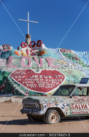Salvation Mountain and Art Car stock photo, CALIPATRIA, IMPERIAL COUNTY, CALIFORNIA, USA - NOVEMBER 28: Bible car and outsider art installation Salvation Mountain on November 28, 2014 in at Calipatria, California, USA. by Scott Griessel