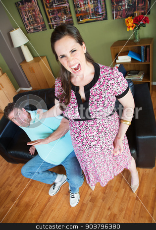 Angry Woman Grabbing Husband stock photo, Angry pregnant woman grabbing her husband's collar by Scott Griessel