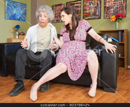 Aggressive Pregnant Wife stock photo, Worried husband being threatened by aggressive wife by Scott Griessel