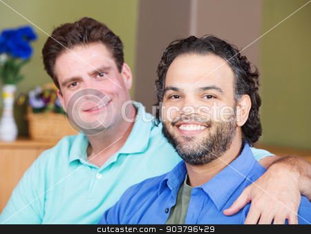 Happy Male Friends stock photo, Mixed affectionate gay men embracing each other by Scott Griessel