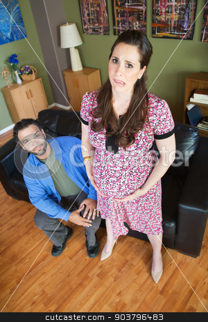 Husband with Exhausted Pregnant Woman stock photo, Patient husband with exhausted pregnant wife biting her tongue by Scott Griessel