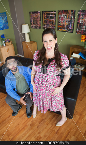 Intense Pregnant Woman stock photo, Husband with excited pregnant wife having contractions by Scott Griessel