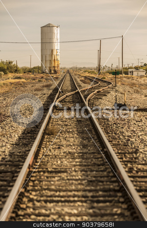 Train Tracks Leading to the Horizon stock photo, Railroad tracks and siding in the historic American west by Scott Griessel