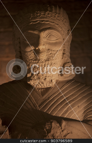 Bearded smiling figure stock photo, Bearded smiling figure carved of stone from Turkey by Scott Griessel