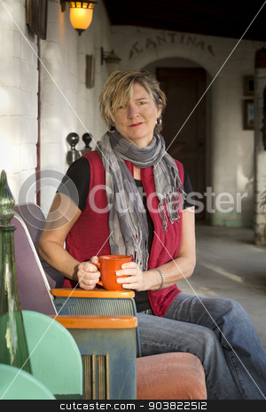 Woman with Coffee on Porch stock photo, Pretty lady drinking morning coffee on porch by Scott Griessel