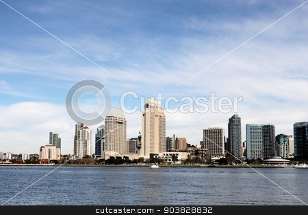 San Diego Skyline stock photo, The skyline of San Diego with water in the front and cloudy blue sky in the background. by Henrik Lehnerer