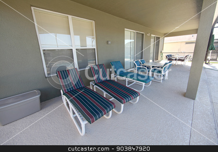 Lanai stock photo, A large lanai in the pool area of a home by Lucy Clark