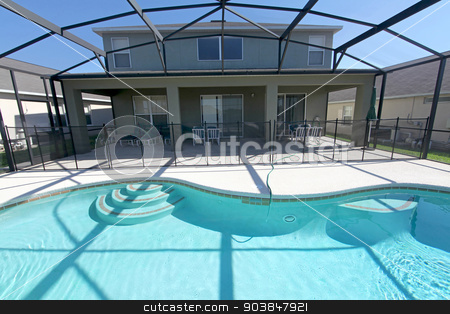 Pool and Lanai stock photo, A pool area with lanai at a home in Florida by Lucy Clark