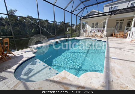 Swimming Pool stock photo, A swimming pool area at a large home by Lucy Clark