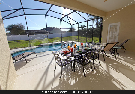 Swimming Pool stock photo, A swimming pool and lanai at a home in Florida by Lucy Clark