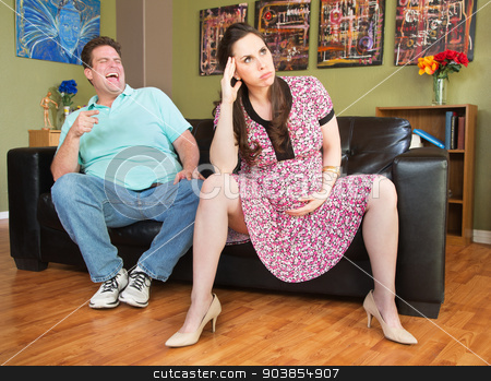 Man Pointing at Pregnant Lady stock photo, Laughing man pointing at angry pregnant woman by Scott Griessel