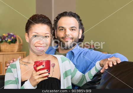 Cheerful Couple with Mug stock photo, Cheerful couple holding hands with red mug by Scott Griessel