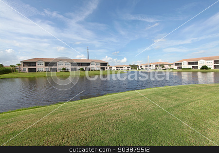 Pond stock photo, A pond in the middle of a resort by Lucy Clark