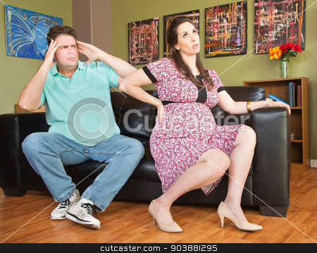 Pregnant Woman with Backache stock photo, Frustrated husband next to pregnant wife with backache by Scott Griessel