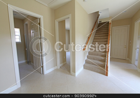 Hallway stock photo, A hallway with stairs and doorways in a home by Lucy Clark