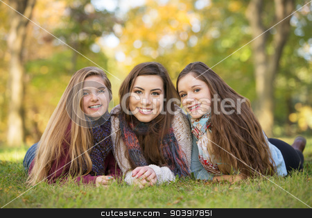 Trio of Friends stock photo, Three happy Caucasian teen girls sitting together by Scott Griessel