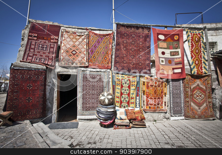 Turkish Rugs Hanging in a Market stock photo, Colorful Turkish rugs being sold in a market by Scott Griessel