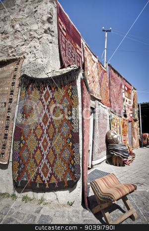 Turkish Rug Vendor stock photo, Vendor selling Turkish rugs in an outdoor bazaar by Scott Griessel