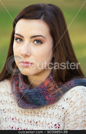 Serious Teen Staring stock photo, Single serious female teenager in sweater staring by Scott Griessel