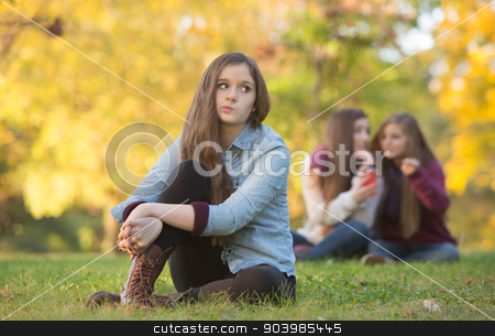 Rumors About Teen Girl stock photo, Caucasian teenager wondering about girls talking behind her by Scott Griessel