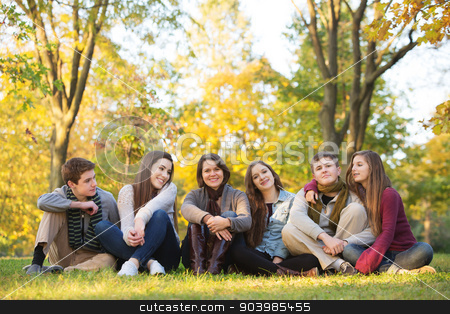 Group of Students with Teacher stock photo, Large group of five teenagers with happy female teacher by Scott Griessel