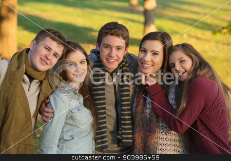 Five Youth Outdoors stock photo, Group of five cheerful youth outdoors embracing by Scott Griessel