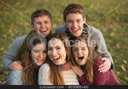 Five Laughing Teens Outdoors stock photo, Five laughing white teenage males and females together by Scott Griessel