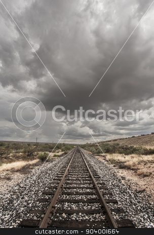 Single Railroad Track in Desert stock photo, Single railroad track with monsoon clouds above by Scott Griessel