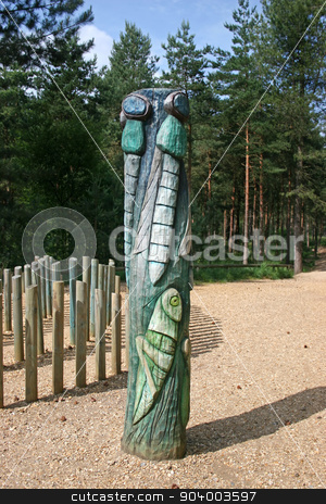 Totem Pole stock photo, A total pole with a cricket and flies in the forest by Lucy Clark