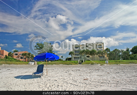 Beach stock photo, A beach with a chair and umbrella by Lucy Clark