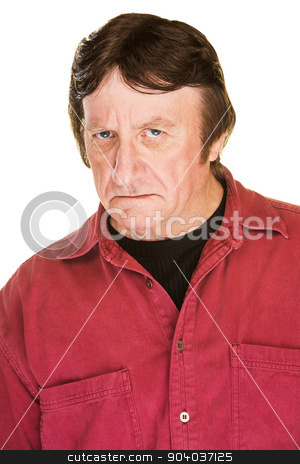 Frowning Mature Man stock photo, Suspicious man in red frowning over white background by Scott Griessel