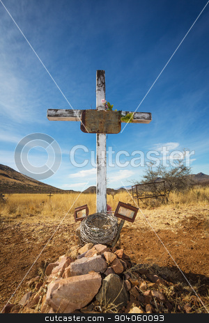 Stone Grave with Blank Frame stock photo, Old shallow stone grave with crucifix and blank frames by Scott Griessel