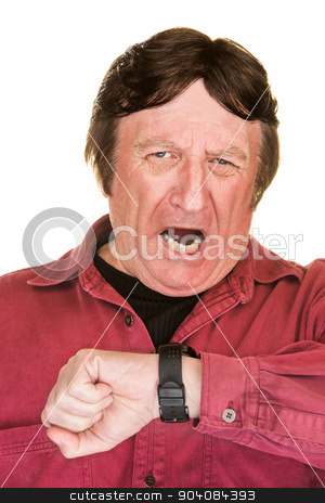 Yawning Man Looking At Watch stock photo, Yawning mature man looking at his watch by Scott Griessel