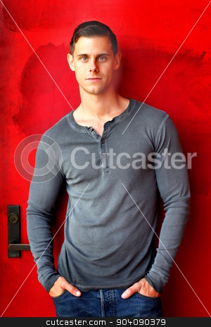 Portrait Of A Man stock photo, Portrait of a man standing in front of a red door. by Henrik Lehnerer