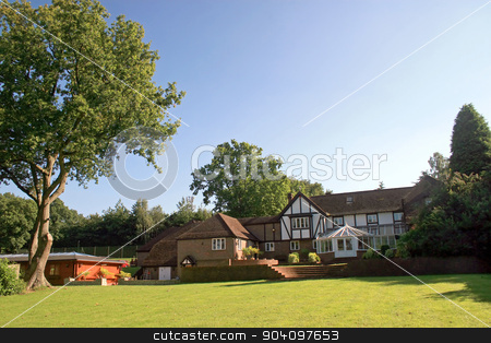 Tudor House stock photo, A large estate home, Tudor style, in the UK. by Lucy Clark